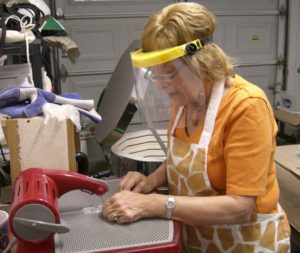 Workin the saw Carol Korfin fused glass